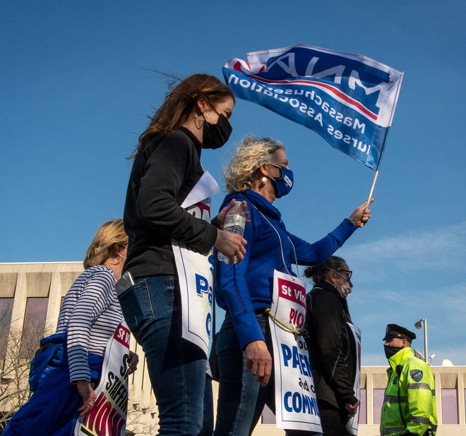 Nurses and supporters continue to walk the picket line outside St. Vincent Hospital on Thursday in Worcester.