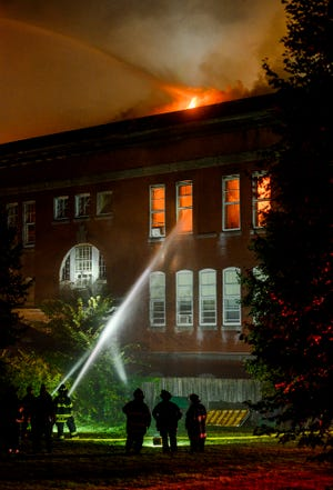 Crews battle a raging fire at the Bartley Nolan Condominiums at 7 Beekman St. in Fitchburg Sept. 22, 2019.