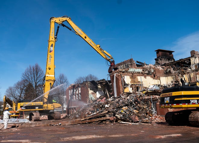 The rubble of the former Bartley Nolan Condominiums is torn down Wednesday. In 2019, a multiple-alarm fire destroyed the building after Raymond L. Jerome detonated two improvised explosive devices, killing himself and leaving the former school uninhabitable.