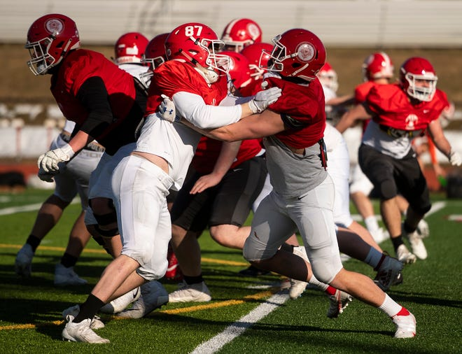 A strong line will be the calling card of the St. John's football team this season.