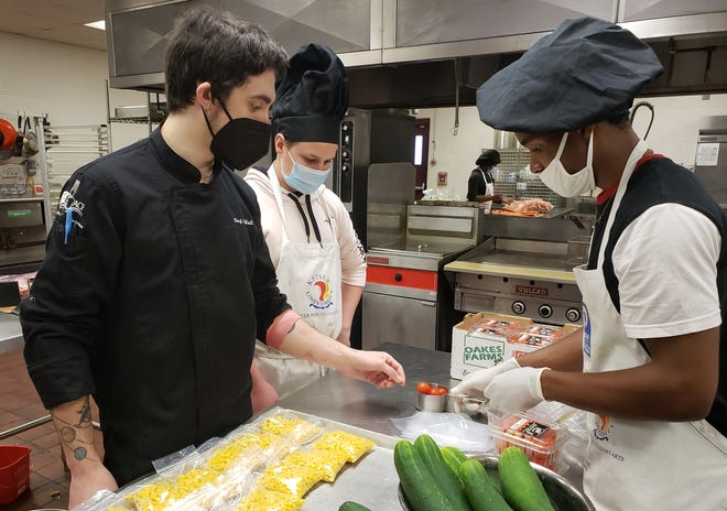 Eastside High School culinary students and a chef prepare meal kits that are being sent to Hawthorne low-income families, who use them to create healthy meals. [Alachua County Public Schools]