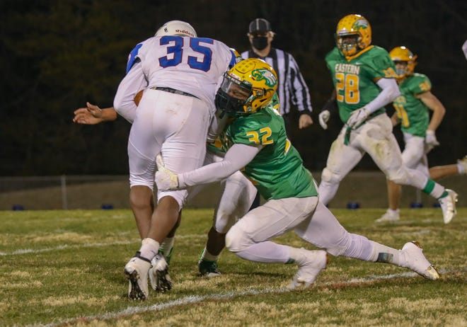 Eastern Alamance defensive back Evan Powell, right, tackles Roxboro Person running back Dashaun Brown in a game last Friday.