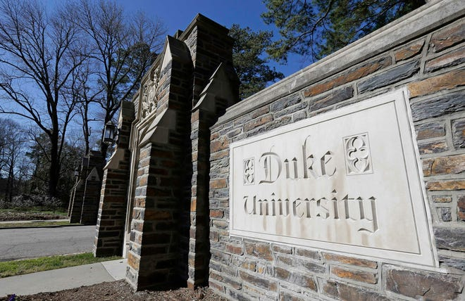 FILE - This Jan. 28, 2019 file photo shows the entrance to the main Duke University campus in Durham, N.C. Duke University announced Wednesday, March 10, 2021, that it is considering ending in-person classes as an uptick in COVID-19 cases over the course of five days worsens and students continue to violate health guidelines. (AP Photo/Gerry Broome, File)