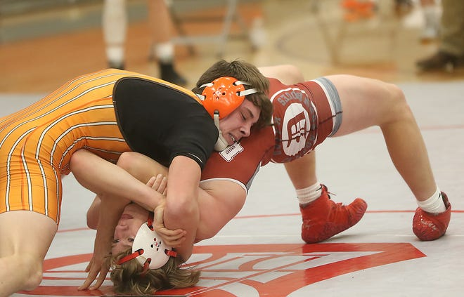 Claymont's Connor Harlan works his way for back points over Dover's Jack Storm in a match this season.