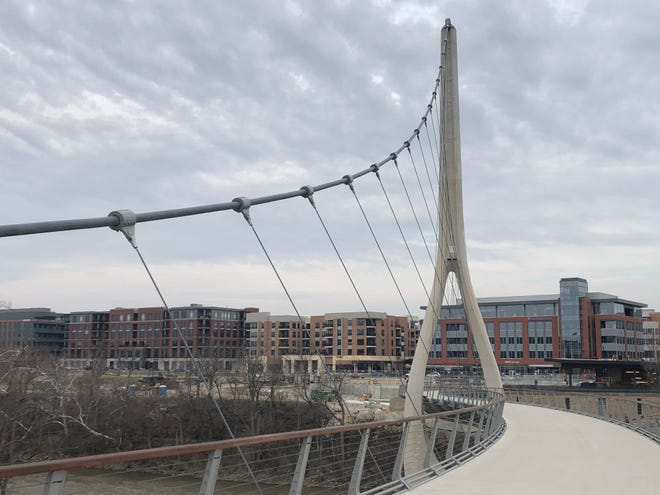 Dublin's Bridge Park development continues to expand. The portion of the development on the east side of the Scioto River, looking east across the Dublin Link pedestrian bridge, is pictured.