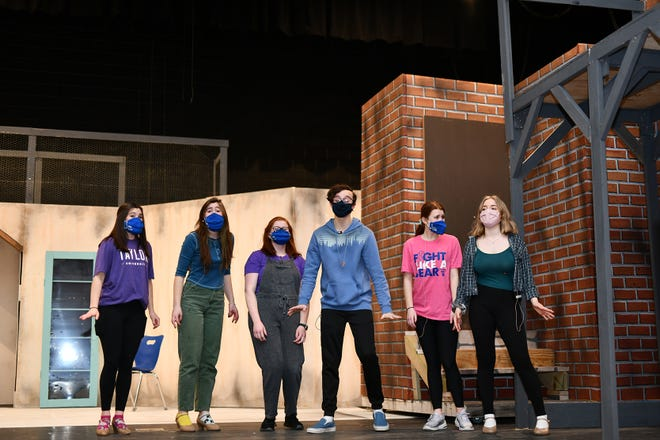 """Olentangy Berlin High School students (from left) Ellie Torlone as Ronnette, Eva Pyle as Urchin, Amelia Thrasher as Patient, Dylan Hagerman as Orin Scrivello, DDS, Gabbie Morrison as Crystal and Maysa Holloway as Chiffon rehearse a scene for the school's production of """"Little Shop of Horrors,"""" with showtimes scheduled for 7 p.m. March 26, 3 and 7 p.m. March 27 and 3 p.m. March 28 at the school, 3140 Berlin Station Road."""