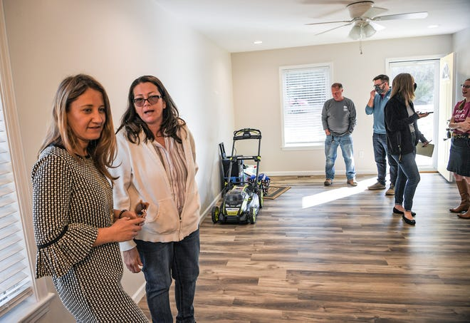Executive Director Angela Wilson, left, and home recipient Liz Miller talk inside after a dedication for the Annual Women Build home, by Habitat for Humanity of Anderson County, in Anderson Thursday, March 10, 2021.