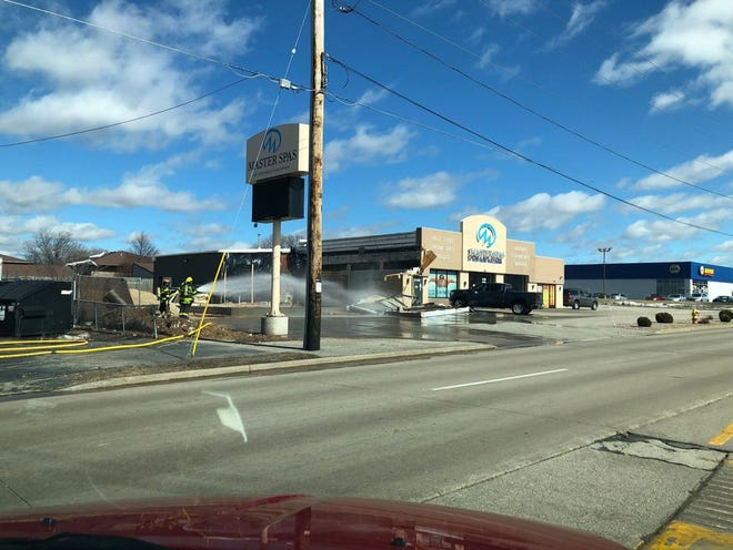 Grand Chute firefighters on the scene of a partial building collapse and natural gas leak at on Thursday, March 11 at Master Spas on West Wisconsin Avenue in Grand Chute.