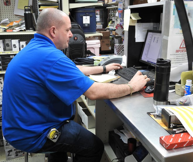 Michael Hunt of Auer Ace Hardware works on an online order for an RC vehicle. The store started selling online about a year and a half ago. The hobby has received a boost since the pandemic and the store is on pace for its best yet of online and in-store RC sales in 2021.