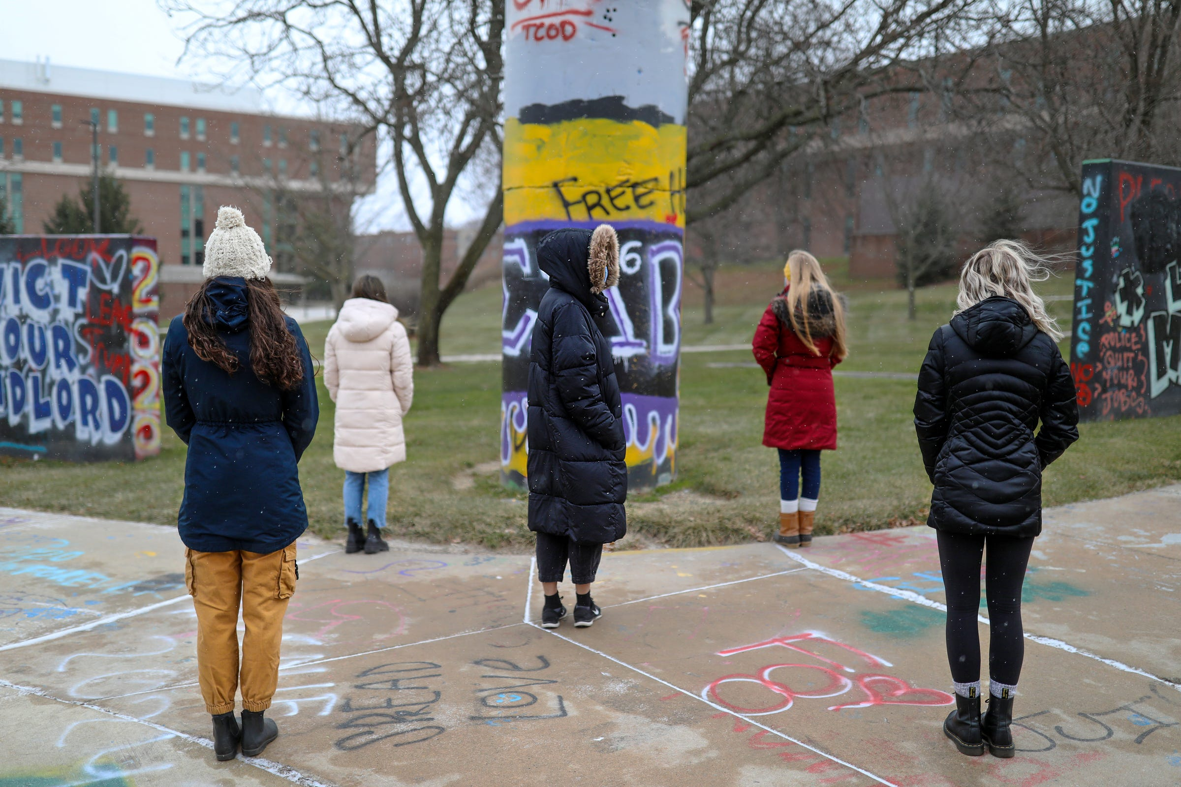 Five women, who came forward to testify about the sexual assault they experienced, now lean on one another for support and are photographed on the Eastern Michigan University campus on Wednesday, Dec. 16, 2020.