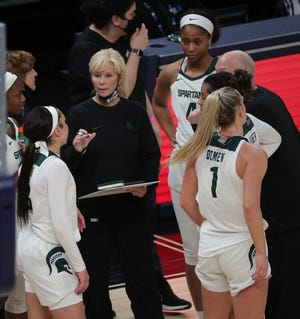 Michigan State head coach Suzy Merchant talks with her team during Big Ten tournament action Wednesday, March 10, 2021, at Bankers Life Fieldhouse in Indianapolis.