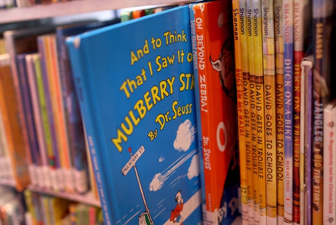 """Books by Theodor Seuss Geisel, aka Dr. Seuss, including """"On Beyond Zebra!"""" and """"And to Think That I Saw it on Mulberry Street,"""" are offered for a loan at the Chinatown Branch of the Chicago Public Library on March 02, 2021, in Chicago."""
