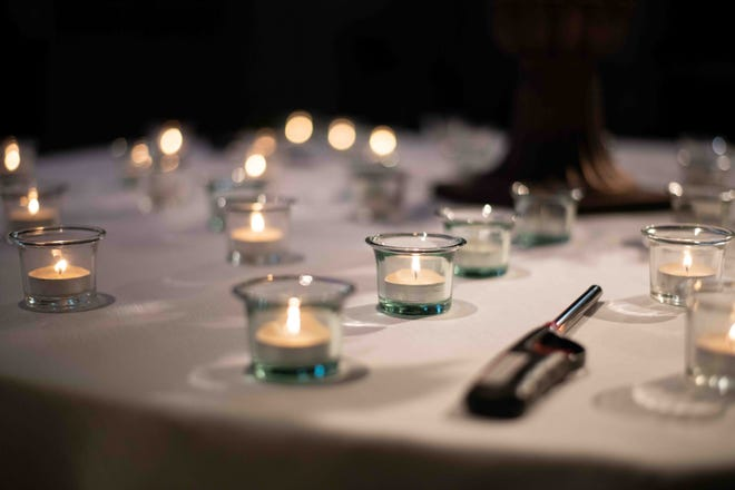 Hospital staff at Forrest General Hospital attend a candlelight service to remember the anniversary of the first COVID-19 case in Mississippi and in Hattiesburg at Forrest General Hospital in Hattiesburg, Miss., Thursday, March 11, 2021.