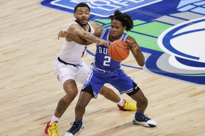 Mar 10, 2021; Greensboro, North Carolina, USA; Louisville Cardinals guard Carlik Jones (1) knocks the basketball from Duke Blue Devils guard DJ Steward (2) during the second half in the second round of the 2021 ACC tournament at Greensboro Coliseum. The Duke Blue Devils won 70-56. Mandatory Credit: Nell Redmond-USA TODAY Sports