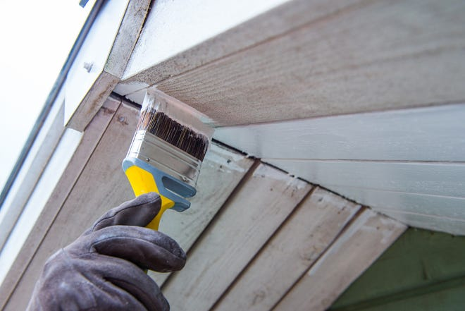 A fresh coat of paint on the front door, garage door and window trim can make a huge difference.