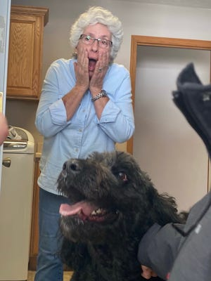 Cheryl Brown reacts to seeing her Labradoodle, Maxie, who ran off and was missing during last month's cold snap.
