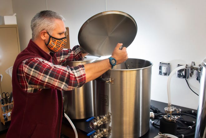 Dr. Clark Danderson works in the new brewery on the campus of AUM.