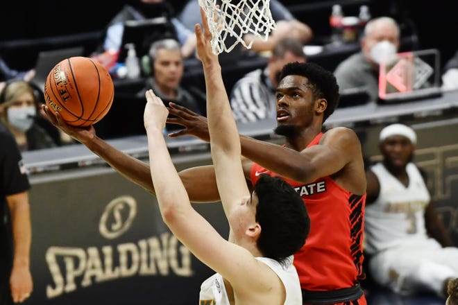 Ball State guard K.J. Walton (1) drives to the basket against Toledo forward Mattia Acunzo (4) during the first half of a MAC Tournament game. Walton is transferring to the University of Akron to play for the Zips and coach John Groce.