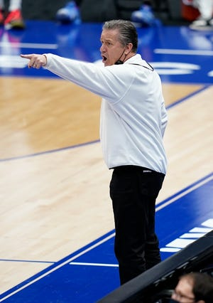 Kentucky head coach John Calipari yells to his players as they face Mississippi State during the second half of the SEC men's basketball tournament game at Bridgestone Arena in Nashville, Tenn.