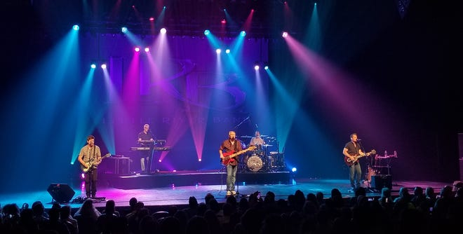 Wayne Nelson, center, with other members of the Little River Band. The group performs March 28, 2021, at Hertz Arena in Estero, Florida. (Photo courtesy of the Little River Band)