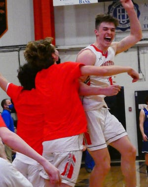 Johnstown senior Gavin Foe (1) celebrates with teammates after the Johnnies beat Collins Western Reserve in a Division III regional semifinal.