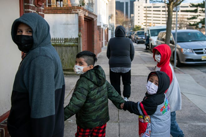 Yessina Moreno walks with her children Sebastian Moreno, 9, from left, Daniel Moreno, 6, Isabel Moreno, 3, and Omar Moreno, 8, outside their home in Atlantic City, N.J. on Thursday, March 11, 2021.