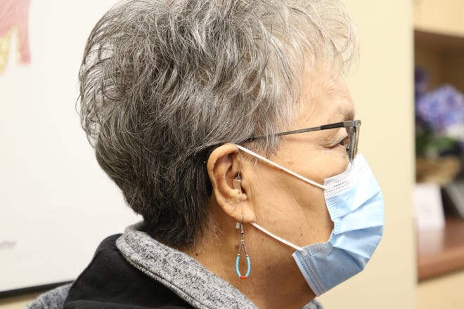 Cecelia Tsosie, 72, of Farmington gets fitted with new hearing aids on Thursday, March 11, 2021, at Sandia Hearing Aids in Farmington. Tsosie battled both cancer and COVID-19 in late 2020, but recovered from both.