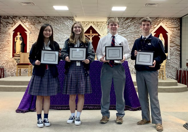 St. Thomas More Catholic High School's finalists in the 2021 National Merit Scholarship Program are, from left, Alaina Le, Catherine Whitehead, Matthew Gower and Ty Martin.