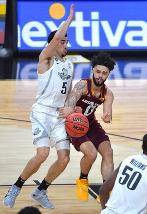 Mar 11, 2021; Las Vegas, NV, USA;  Arizona State Sun Devils guard Holland Woods (0) passes the ball away from Oregon Ducks guard Chris Duarte (5) during the first half at T-Mobile Arena. Mandatory Credit: Stephen R. Sylvanie-USA TODAY Sports