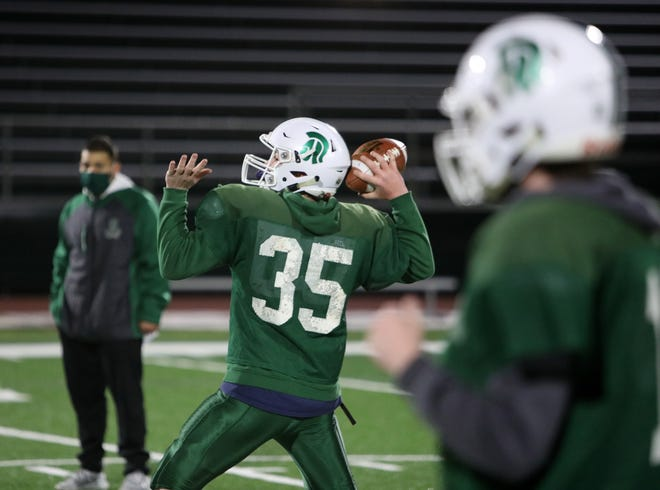 Spackenkill football head coach Clinton Desouza observes his offense run a play during Wednesday's practice in the Town of Poughkeepsie on March 10, 2021.