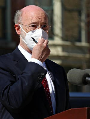 Gov. Tom Wolf adjusts his mask while speaking to media during a visit to Family First Health in York City, Thursday, March 11, 2021. Gov. Wolf praised the health center for their diligence during the COVID-19 pandemic as well as for their efforts to get the COVID-19 vaccine to the members of the eligible and sometimes vulnerable members of the community. Dawn J. Sagert photo