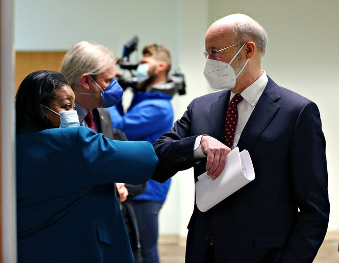 Gov. Tom Wolf elbow bumps York City School District Superintendent Dr. Andrea Berry during a tour visit to Family First Health in York City, Thursday, March 11, 2021. Gov. Wolf praised the health center for their diligence during the COVID-19 pandemic as well as for their efforts to get the COVID-19 vaccine to the members of the eligible and sometimes vulnerable members of the community. Dawn J. Sagert photo