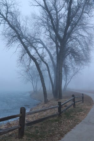 The Sioux River Red Rock Trail winds through Dells on a foggy morning last December.