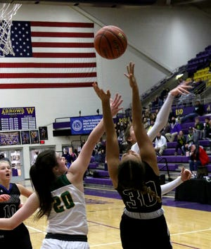 Sioux Falls Christian sophomore Mariah Harrison hits a reverse layup during the first half of the Chargers' game against Aberdeen Roncalli in the first round of the Class A State Tournament in Watertown Thursday.