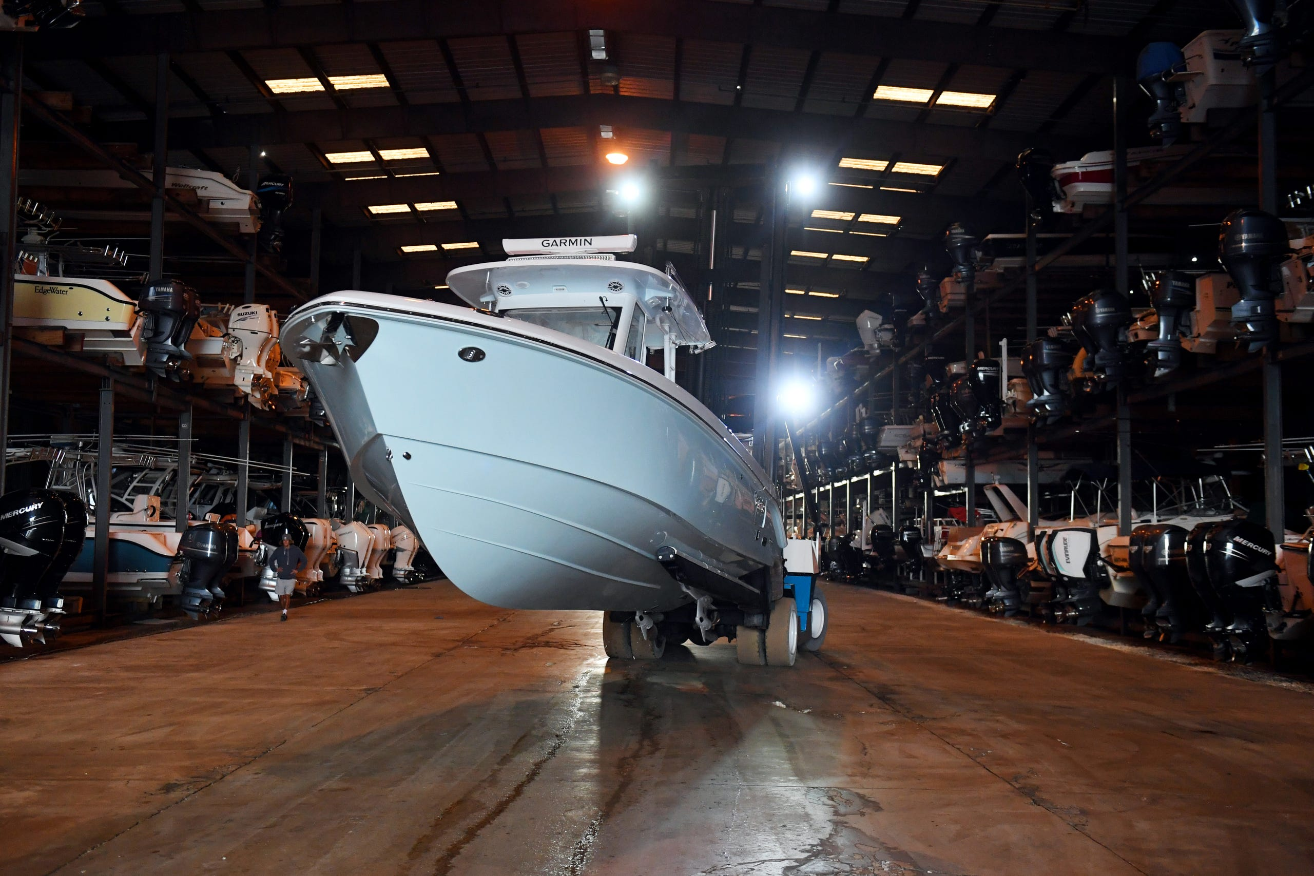 A boat is slowly placed in dry dock on Tuesday, March 9, 2021, at Meridian Marina in Palm City. Austin and Jenny Cameron, of Austin, Texas, recently took ownership of the marina and are planning to increase storage capacity, open a repair shop and add a waterfront restaurant.