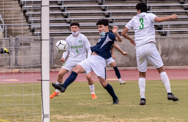 Redwood's Will Kennedy scores against Roosevelt in boys soccer on Wednesday, March 10, 2021.