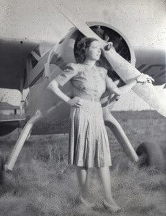 Jimmie Kolp with a Cessna, one of nine airplanes she kept at her airport near Electra.