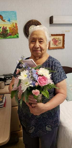 Juanita Lopez poses with Mother's Day flowers in this undated photo.