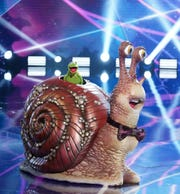 "Kermit the Frog is revealed to be Snail on the Season 5 premiere of ""The Masked Singer."""