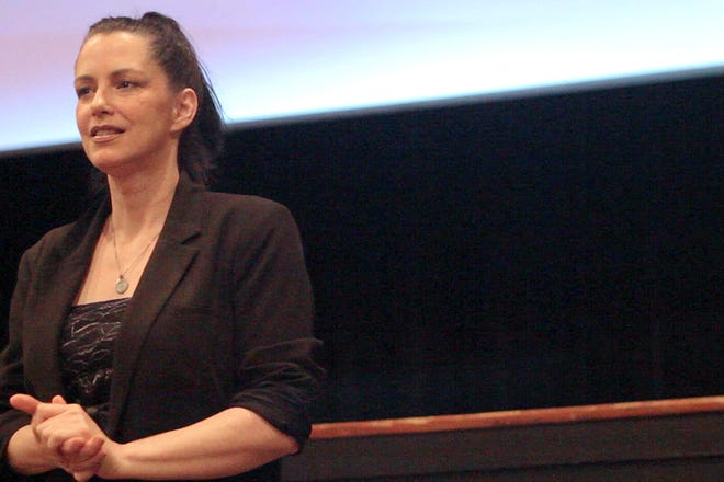 """Independent filmmaker Debbie Rochon fields questions from the audience following the premiere screening of her feature directorial debut, """"Model Hunger,"""" at the 2015 Crimson Screen Film Festival in Charleston, NC."""