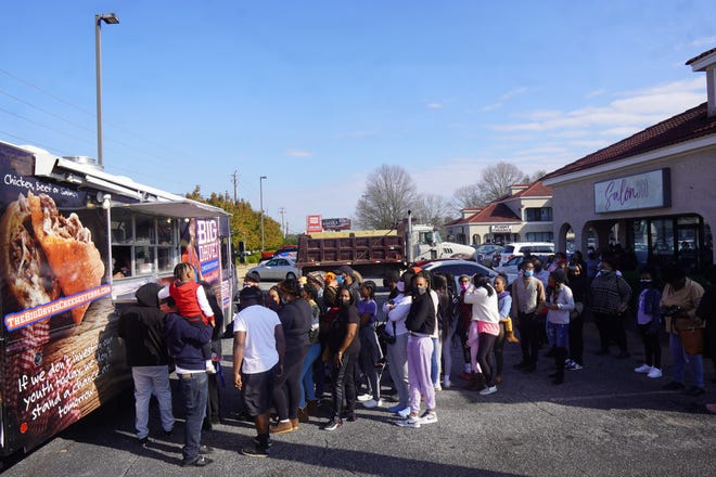 This photo dated Feb. 9, 2021 shows a line of Big Dave's Cheesesteaks customers wrapped around the Salon 360 building in Athens, Ga. The food truck, owned by restauranteur and former Clarke Central High School athlete Derrick Hayes, will be back in Athens on Sunday, Mar. 14.