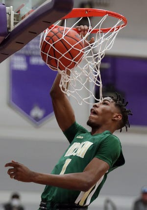 STVM's Sencire Harris dunks the ball during the first half of a Division II regional semifinal against the Struthers Wildcats, Thursday, March 11, 2021, in Barberton, Ohio. [Jeff Lange/Beacon Journal]