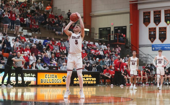 Shelby's TJ Pugh shoots the second shot of a technical after an intentional foul call against Lima Shawnee in the second half of the  Division II regional semifinal boys basketball game at Elida High School on Thursday March 11, 2021 in Elida, Ohio. Lima Shawnee defeated Shelby 76 to 67.