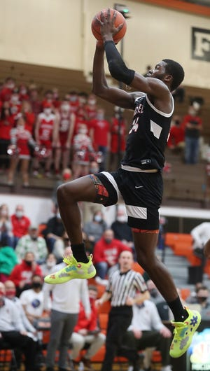 Buchtel's Chris Livingston soars to the basket against Toledo Central Catholic in the Div II regional semifinal  boys basketball game at Elida High School on Thursday March 11, 2021 in Elida, Ohio. Buchtel defeated Toledo Central Catholic 68 to 51.