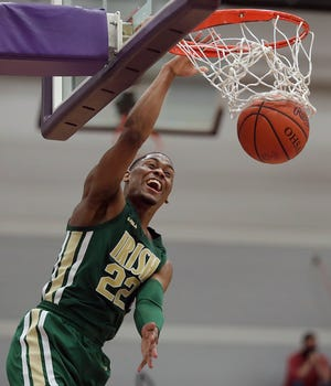 St. Vincent-St. Mary senior guard Malaki Branham dunks during the second half of a Division II regional semifinal win over Struthers. Branham hopes to end his STVM career with two more wins and a state championship. [Jeff Lange/Beacon Journal]