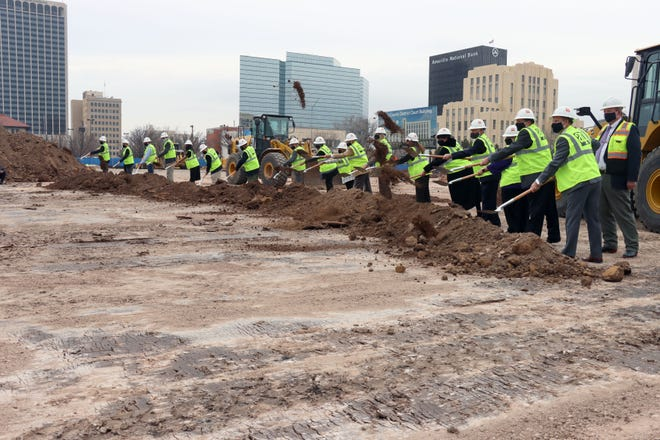 Officials from Potter County, HOK Architects and Adolfson & Peterson Construction shovel dirt for the new home of Potter County District Courts building in downtown Amarillo Friday.