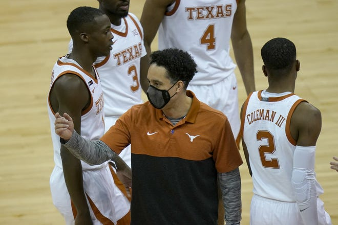 Texas coach Shaka Smart gathers his team during a timeout in Thursday's 67-66 win over Texas Tech in the Big 12 Tournament quarterfinals in Kansas City, Mo.