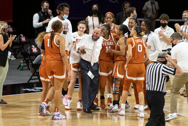 Texas coach Vic Schaefer celebrates with his players after Friday's win over Iowa State. The Horns will face top-seeded Baylor in Saturday's semifinals.