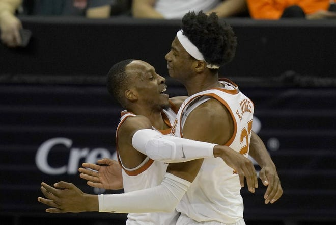 Texas guard Matt Coleman III, left,  celebrates with forward Kai Jones after Thursday night's 67-66 win over Texas Tech in the Big 12 tournament quarterfinals. Coleman sank two free throws with 1.8 seconds left to lift the Longhorns.