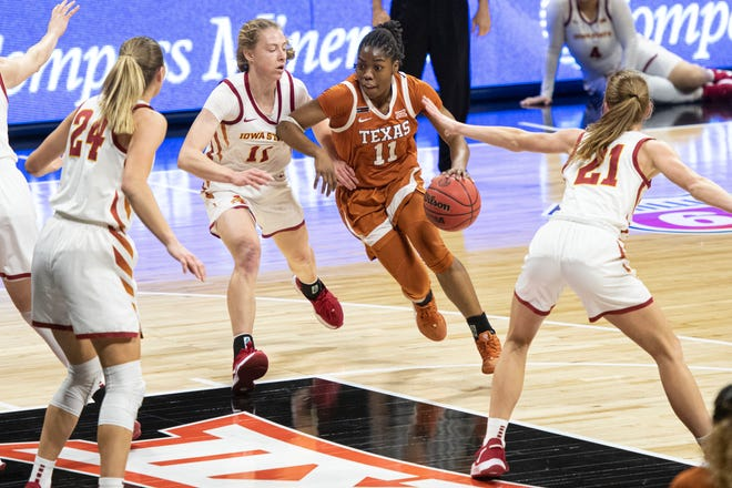 Texas guard Joanne Allen-Taylor drives past Iowa State guard Emily Ryan in the first half of the Longhorns' 84-82 overtime win in the Big 12 Tournament quarterfinals. The Longhorns will face top-seeded Baylor in Saturday's semifinals.